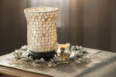 The Pink Zebra Shell Urn Shade adds the perfect reflective touch to any decor!