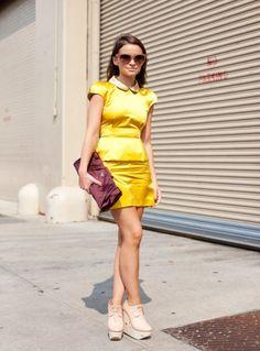 Miroslava Duma - Miu Miu dress, Prada Raso Gathered Clutch, and Céline 'Audrey' Sunglasses.