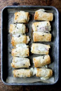 Hit with a drizzle of honey out of the oven, these salty-sweet, flaky salami and provolone phyllo rolls are irresistible. You can also assemble them ahead of time and stash them in the fridge or freezer until needed. Phyllo Dough Recipes, Appetizer Recipes, Appetizers Superbowl, Healthy Appetizers, Half Baked Harvest, Sweet And Salty, Finger Foods, Yummy Food, Yummy Recipes