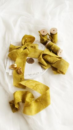 Hand dyed silk habotai ribbon in beautiful ochre yellow color with a marble effect along #naturalsilk #organicsilk #silkribbon