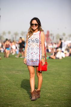 50+ Stylish Folks Who Rocked Coachella #refinery29 http://www.refinery29.com/coachella-style#slide10 Song of Style's Aimee Song is the vision of easy-breezy in pull-on boots, a lace dress, and a crossbody bag.