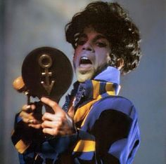 Prince checking himself out on the Act II Tour 1993! (Great rare photo! I had forgotten about that mirror with symbol stage prop!)