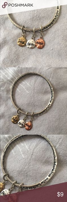 """NWOT """"Faith Hope Love"""" bracelet This bracelet is super cute and has the """"our father"""" prayer written on it along with charms that read """"faith, hope, and love"""" in perfect condition. From a smoke free home Accessories"""