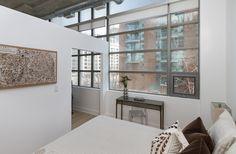 Tip Top Lofts, Toronto - Photos Concrete Ceiling, Toronto Photos, Art Deco Buildings, Bedroom Loft, Stainless Steel Appliances, Window Wall, Workout Rooms, Lofts, Laminate Flooring