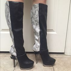 Black and Snake Print High Heel Boots ❤️ Brand new without box. These boots are beautiful and in perfect condition. Never worn. Side zipper and they come right below the knee. Heel is approximately 5 3/4 inches. Shoe Dazzle Shoes Heeled Boots