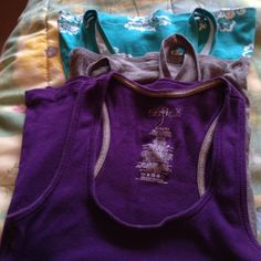 Tank top bundle turquoise , grey, purple Not size medium I would say xs - small  used condition, nice and long Mossimo Supply Co Tops Tank Tops