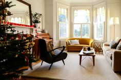 Lively Yellow Sofas Providing Brightness in Interior Look: Breathtaking Transitional Living Room Design With Yellow Sofa White Pillows White. London Living Room, Living Room Sets, Living Room Designs, Room London, Yellow Sofa Design, Yellow Couch, Lyon, Dado Rail, Classic Living Room