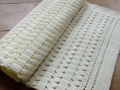 So the blanket had to be:  suitable for both boys and girls, light enough for summer but big enough to wrap around in winter, trendy with a traditional style,  above all NOT frilly!