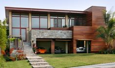 Esquisite Garage Doors Decals Housing Design: Amazing Garage Door Opened Design For Modern Style Home Details Wooden Exterior And Glass Windows Combined With Rustic Stone And Green Grass Frontyard ~ novavn.com Decorating Inspiration