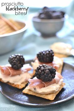 Prosciutto Blackberry Bites with Honey Pecan Cream Cheese, all on a cracker