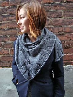 Drop Stitch Technique.  Fun to do and creates a fantastic design element.  Ravelry: Tattered pattern by Sachiko Burgin {free}.