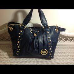 """Michael Kors Hobo Lamb leather the softest bag there i.e. In any of  MK collections bag is navy blue with gold grommets! This bag is really a sexy bag! D""""11 x A""""16 x D""""5! Handle drop 6.5""""! Cross strap! 5 pockets one with zipper, outside has 2 side pockets! This was one of my hand me downs from my mom in impeccable shape I don't see any scratches on any off the gold, but those are my eyes! I don't model bags and MSRP: $599.00 TV $350.00 Michael Kors Bags Hobos"""