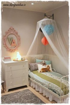 Girlsroom for an 8 year old. Serene and calm, hints of pink and light teal. http://www.skreytumhus.is/?p=19654