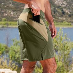 This quick drying, lightweight zipper pocket short is built to excel in hot and wet environments. Buy this verge II olive workout short from HYLETE today! Mens Gym Shorts, Track Pants Mens, Boxer Pants, Le Polo, Polo T Shirts, Sport Shorts, Cycling Outfit, Shorts With Pockets, Short Outfits