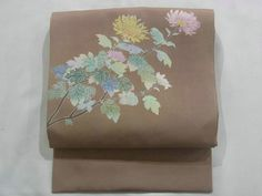 This is a chic Shioze Nagoya obi with Kaga-style design of 'Kiku'(chrysanthemum), which is dyed