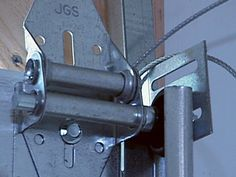 DIYNetwork.com has step-by-step instructions on how to install a garage door.