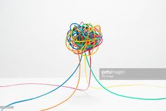 Different colored wires coming together to create a ball in mid air on white background Electrical Grid, Come Together, Different, Tangled, Royalty Free Images, Crochet Necklace, Wire, Stock Photos, Create