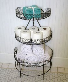 Try stand-alone metal shelving to hold your bathroom essentials, like toilet paper and towels. | HellaWella #organization #homeorganization #organizationtips