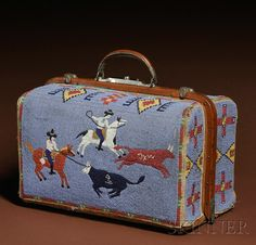 Beaded Suitcase, Lakota, c. late 19th century,  with classic 19th century  lg. 17, ht. of beadwork 10 1/2, wd. 10 in.Sold for $124,425