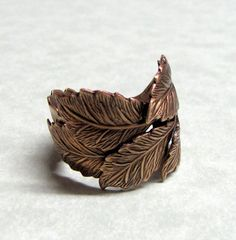 I like finding a chunky ring that isn't silver-- doesn't clash with my wedding band/engagement ring. Leaves of the Forest Ring by ranaway on esty.