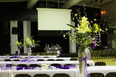 Purple and yellow centerpieces, gym wedding/reception