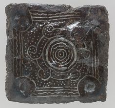 Back Plate of a Belt Buckle  Date:late 6th–7th century Culture:Frankish Medium:Iron with silver inlay Dimensions:Overall: 1 7/8 x 1/4 x 1 3/4 in. (4.7 x 0.7 x 4.5 cm) Classification:Metalwork-Iron Credit Line:Gift of J. Pierpont Morgan, 1917 Accession Number:17.193.99