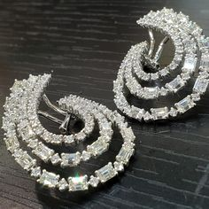"""Creating the """"Wow"""" factor with these baguette and round cut white diamond earrings. The ideal eye-catching accessory which adds undisputed elegance to that formal look by Photo Jewelry, Fine Jewelry, Jewellery, Diamond Studs, Diamond Earrings, Gold Earrings Designs, Wow Products, Designer Earrings, Jewelry Trends"""