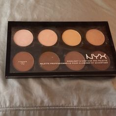 NYX Powder Contour Pallette Gently used a few times. Darker colors untouched. Price is lowest. Bundle for additional discounts. NYX Makeup Face Powder
