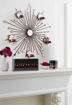 It's magic! Polished metal and mirrored glass make four tealights look like dozens of flickering flames.