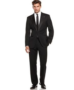 i want my husband in a simple black suit with a skinny black tie. no vest or fancy stuff (: