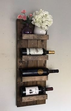 Handcrafted and high quality! Wall mounted wooden wine rack and wine bottle display holder. Stylish way to hang your wine bottles and prevent dry corking! Would be great as a housewarming gift, wedding gift, or used in your own home in your kitchen, above your bar, etc!  Dimensions: 6 Bottle Wine Rack: 42T x 10.5W x 5.75D 5 Bottle Wine Rack: 36T x 10.5W x 5.75D 4 Bottle Wine Rack: 30T x 10.5W x 5.75D 3 Bottle Wine Rack: 24T x 10.5W x 5.75D 2 Bottle Wine Rack: 18T x 10.5W x 5.75D  Very…