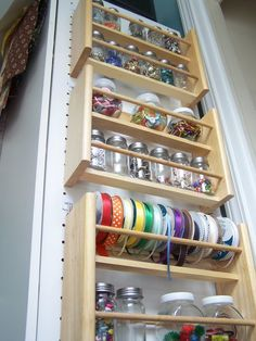 Use jars and spice bottles for notions, buttons, embellishments. Hang units like these inside of cupboard doors. {dp}