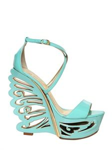 I'd be afraid to stand in these, but I love the creative use of cutouts.  - LUISAVIAROMA