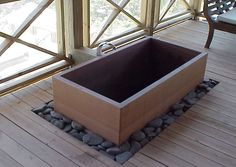 Japanese ofuros, furos & baths, custom!  Pretty nice, but I imagine mine outside to drain into the garden.  It'll have to be teak.