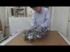 http://www.curvedfolding.com/video/freeform-origami