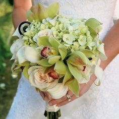 The bouquets picked up the white and green color scheme with green hydrangea, green orchids, and white roses.