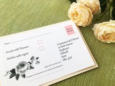 Botanical rose wedding invitation demonstrating the perforated reply card on the back. Using blush pink as the colour scheme.