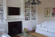 Living room remodel with custom built-in shelving