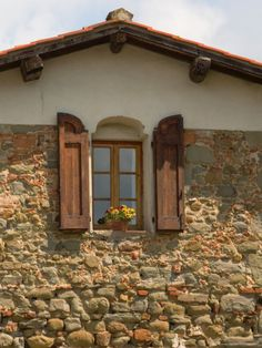 Window and Shutters with Flowerbox of Yellow Flowers, Figline Village, Tuscany, Italy