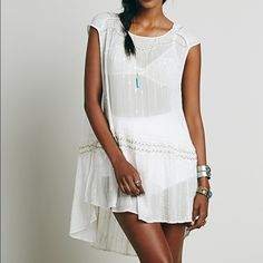 Free people embellished tunic Free people embellished tunic. Size small. Side slits.  worn ONCE. No snags or beading missing.  Basically brand new. So beautiful. Sleeveless style. Color ivory. 30 in from shoulder to hem in front. 33 in from shoulder to hem in back. Free People Tops Tunics