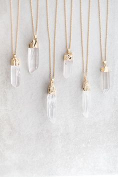 Long clear quartz pendant necklace.