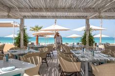Enjoy Greek delicacies and an award-winning drinks list at this photogenic beachside restaurant Dubai Beach, Drink List, Greek, Relax, Restaurant, Patio, Table Decorations, Outdoor Decor, Traveling
