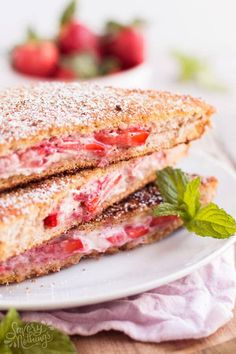 This Healthy Cream Cheese Strawberry Stuffed French Toast is the easy Sunday family breakfast recipe we keep coming back to! It is homemade with whole wheat bread, low fat cream cheese, strawberry slices and maple syrup. The crunchy cinnamon coating makes it the perfect simple brunch sandwich for kids. We especially love how fluffy it turns out while still counting as a healthy option - the best of both worlds! Click through to get the full instructions to make the best stuffed french toast!