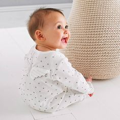 An adorable cotton babgrow featuring tiny soft angel wings on the back . £22.50