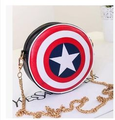 Captain America Round Shield Purse Size: 6.3 inches in diameter, 2.1 inches thick Made with PU Leather Comes with 4 ft gold chain strap