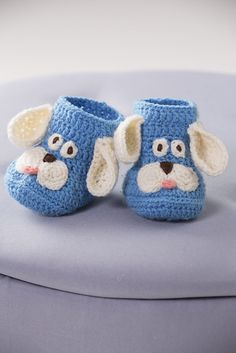 Crochet these adorable puppy booties for the baby in your life! Any of the colours of our soft Baby yarn can be used as the main shade.