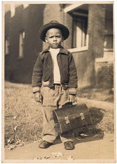 Boy with a lunchbox. Is he going to school ?