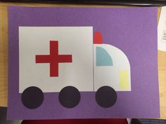 Ambulance craft made by gluing pre-cut shapes of paper onto coloured card