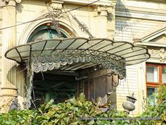 Clamshell doorway canopy, Little Paris style house, Mosilor area, Bucharest (©Valentin Mandache) Architecture Old, Historical Architecture, Little Paris, Marquise, Bucharest, Belle Epoque, Doorway, Canopy, Facade
