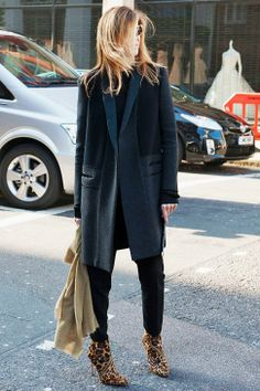 Leopard booties make this all-black outfit pop